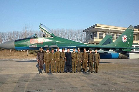 Undated handout picture of Korean leader Kim Jong-Un posing with soldiers as he visits Unit 1017 of the Korean People's Army Air Force in an undisclosed location